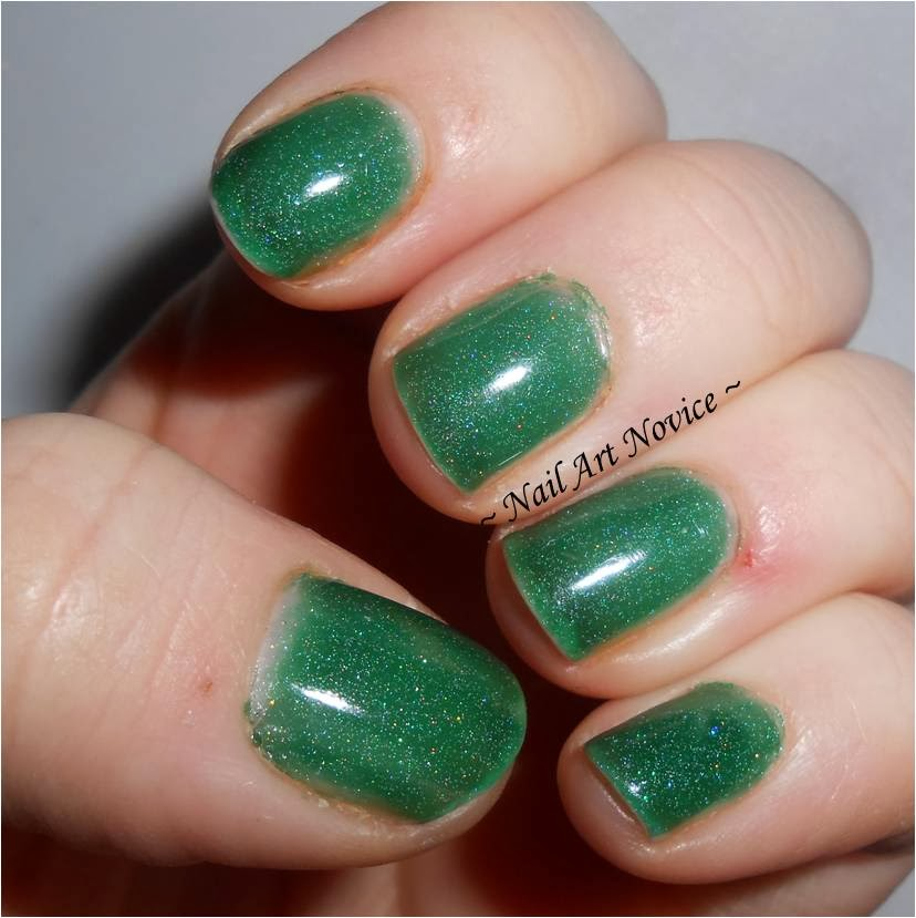 Swatches of Black Cat Lacquer-Evergreen, warm state