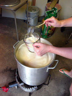 Audrey scooping foam to prevent a boil-over.