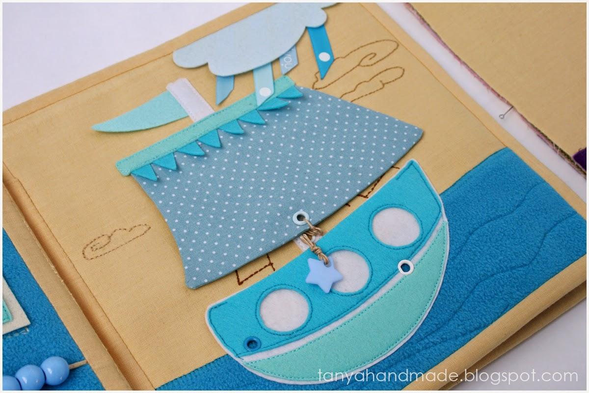 quiet book rainbow, развивающая книга, тихая книга, книжка развивайка, игрушка для ребенка, радуга, аппликации, стильная игрушка, подарок ребенку, качественная книга, стильный подарок, качественный подарок, эксклюзивный подарок, фетр, аппликации из фетра, ручная работа, из фетра, пуговицы, голубой, парусник, кораблик, мультяшный кораблик, поднятие паруса. Фетровая аппликация, аппликация из фетра, стильный кораблик.