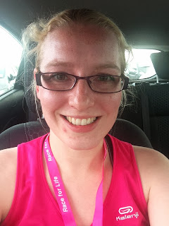 A sweaty woman in pink after running Race for Life