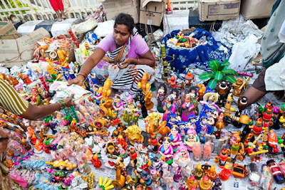 Hyderbad - Vendor at street stall at foot of of the Charminar
