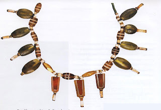Necklace, Harappa, ca. 3000 BC  Recovered from an excavation of an Indus Valley site, this necklace shows an almost contemporary sophistication. The necklace is of steatite and gold beads with pendants of banded agate and jade.
