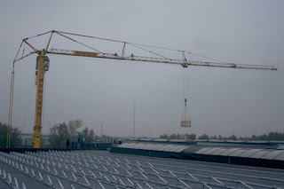 Big Crane Unloading Solar Panels