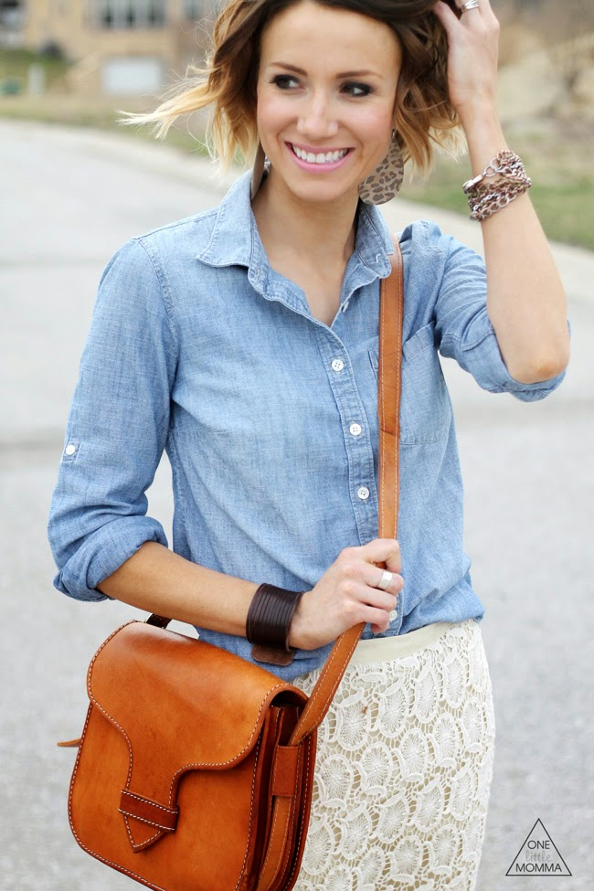 Chambray shirt paired with a crocheted/lace skirt and ankle boots. Love the camel cross body bag as well!