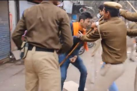 A video shows male constables of Delhi Police beating up agitators, including women, who were protesting against the death of Dalit scholar Rohith Vemula.   The incident occurred on Saturday near the RSS head office.