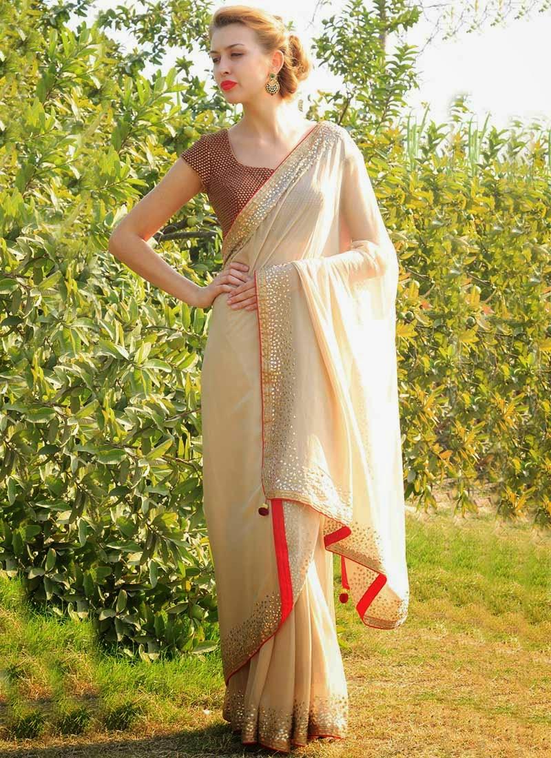 http://www.cbazaar.com/party-wear-saree/dazzling-diva/stunning-beige-pure-georgette-saree-p-sadsinsse013.html