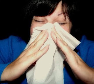 Woman sneezing from a cold