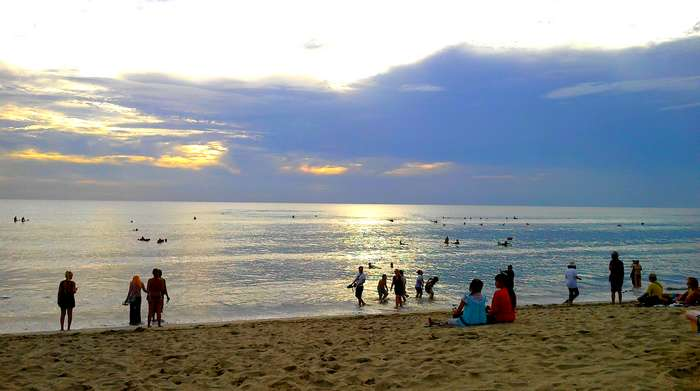 When the evening at Kuta Beach, Bali