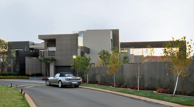 Modern home and car parked in front