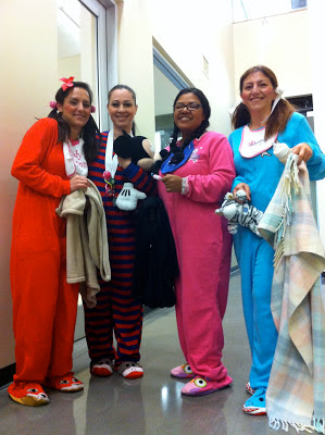 4 women dressed in baby costumes for halloween