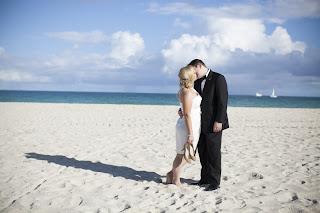 Bride & Groom Kissing on Beach