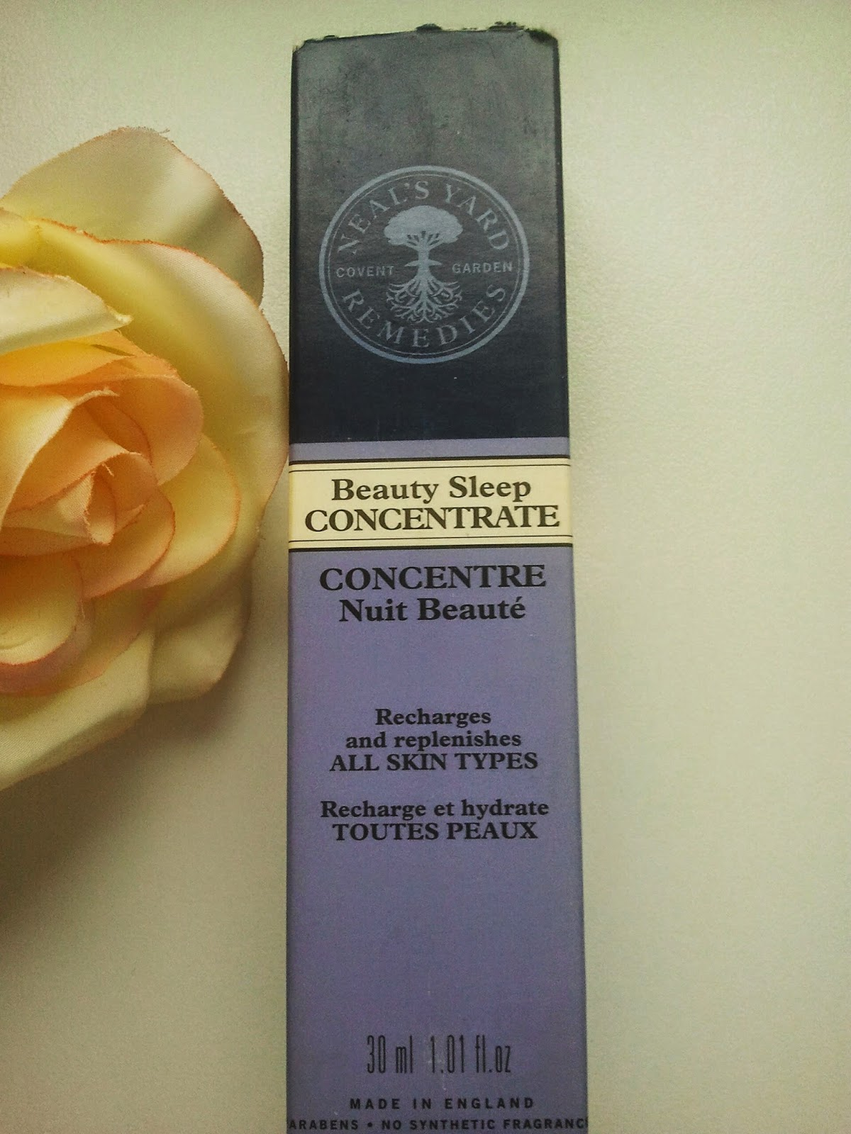 Neal's-Yard-Remedies-Beauty-Sleep-Concentrate-on-my-table-with-a-rose