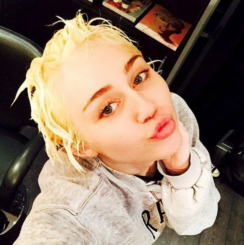 Hairy affair | New style: Miley Cyrus makes on Justin Bieber