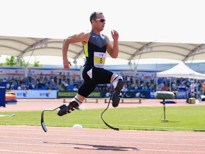 Pistorius running on his two carbon fiber prosthetic blades.