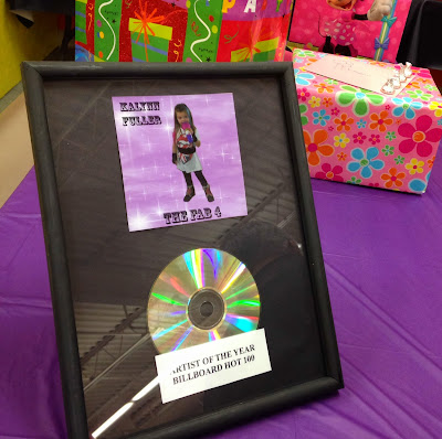 Billboard Hot 100 award for decoration at a rock star birthday party. Use an old CD and frame. www.thebrighterwriter.blogspot.com