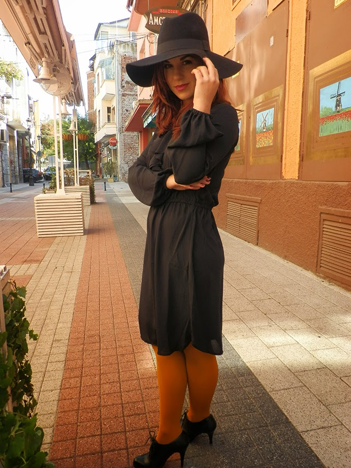 Personal style: Black H&M Chiffon Dress and wide brimmed fedora, mustard H&M tights, Black leather shoes Vera Pelle