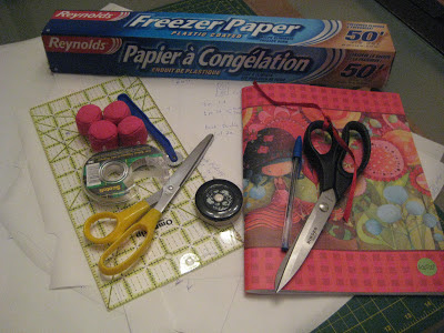 Freezer paper, scissors, tape measure, scotch tape, pattern weights, tracing wheel, ruler, self healing mat, pen and notebook.