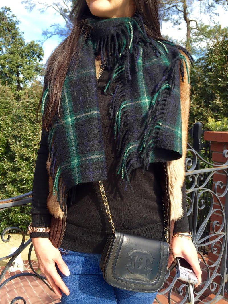 Close up of plaid scarf over the faux fur vest.