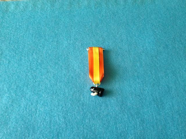 Medalla en fimo de la bala del videojuego Mario Bros