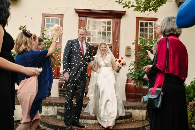 Vintage bride Sarah leaving the Church in a shower of confetti!