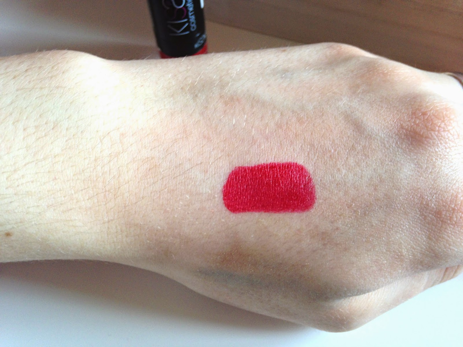 Kiss Cosmetics KISSstick Caressing Red Swatch