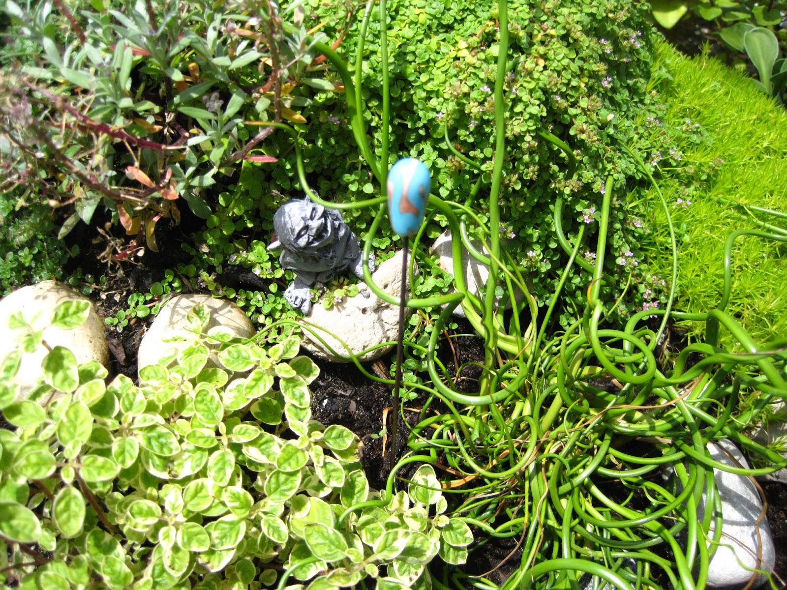 every day is art garden troll enjoys handmade glass art