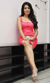 Actress Surabhi  Images in Red Dress at an Event