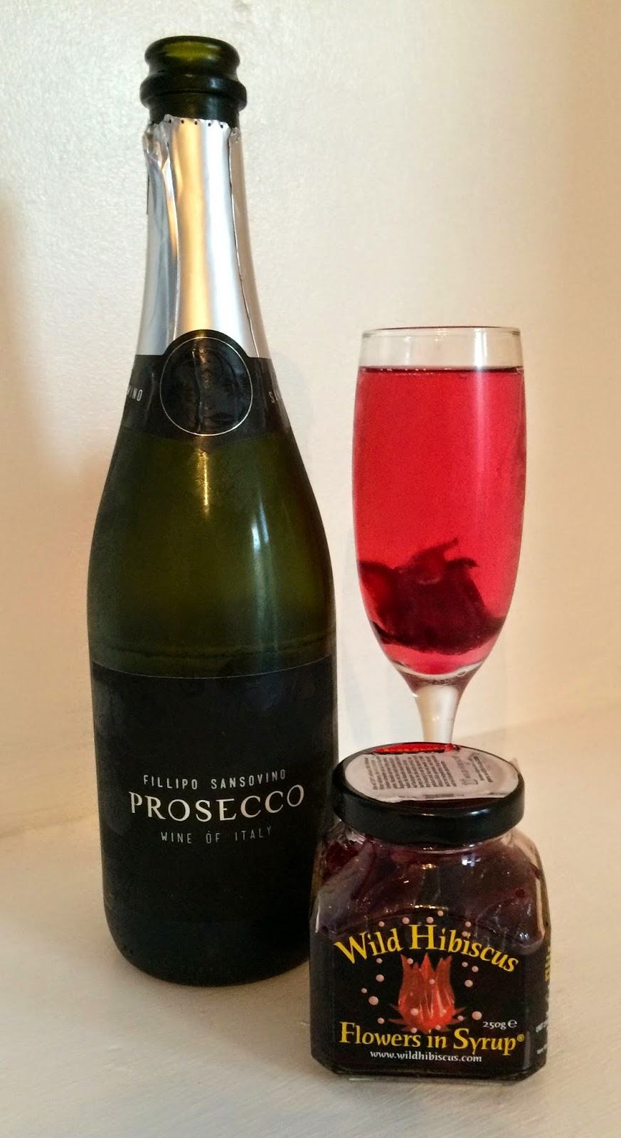 Pretty luscious things wild hibiscus flowers with prosecco prosecco wild hibiscus flowers in syrup wedding drink ideas toasts at events izmirmasajfo
