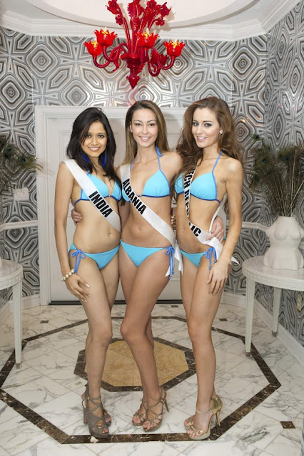 Miss India Shilpa Singh (L-R), Miss Albania Adrola Dushi, and Miss Czech Republic Tereza Chlebovska pose for photos in swimwear in Las Vegas, Nevada December 11, 2012