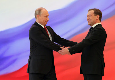 Putin and Medvedev shake hands