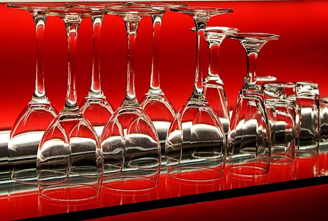 wine glasses on a glass shelf