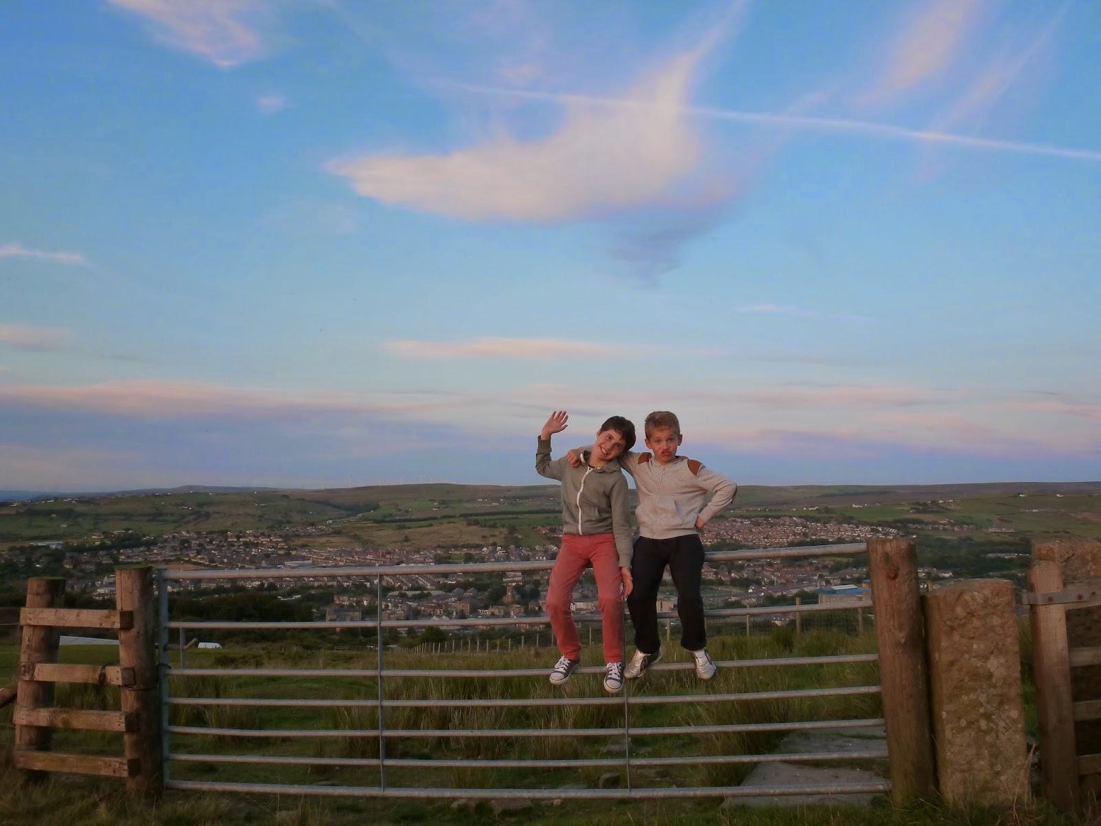 boys sitting on fence