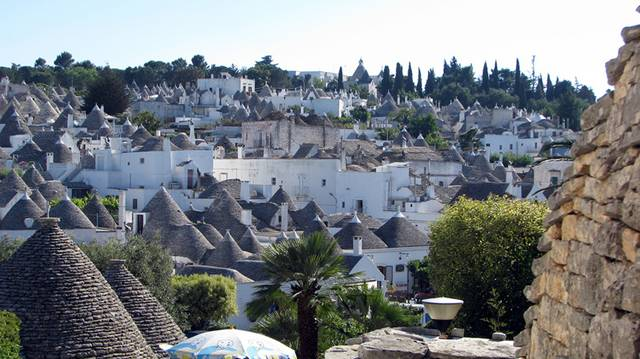 Alberobello, the city of drystone dwellings known as trulli , is an exceptional example of vernacular architecture. It is one of the best preserved and most homogeneous urban areas of this type in Europe. Its special features, and the fact that the buildings are still occupied, make it unique. It also represents a remarkable survival of prehistoric building techniques.
