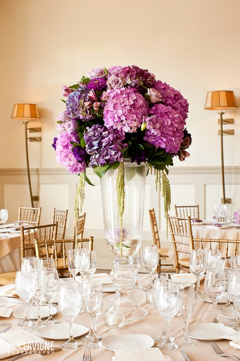 We did a combination of tall and low style centerpieces with purple