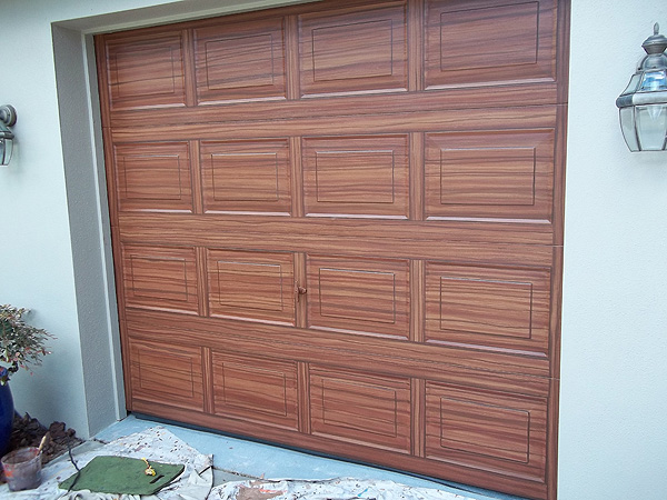 Finished the single car garage door everything i create for Paint garage door to look like wood