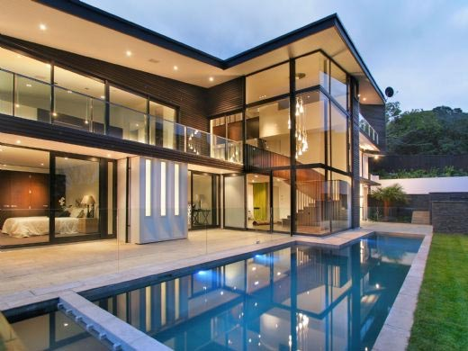 Modern Glass House Frames Luxurious Features