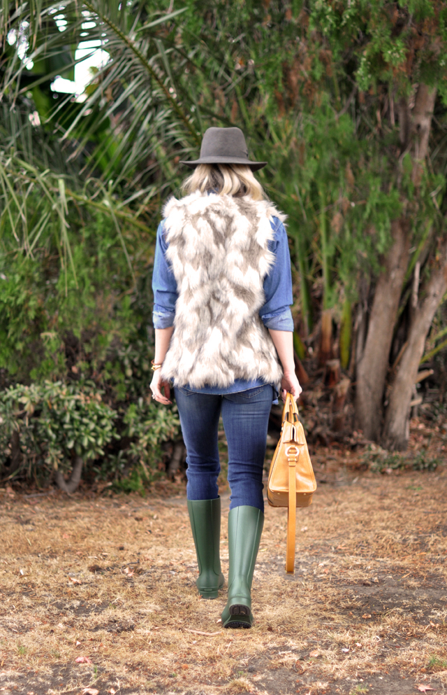 denim shirt, fur vest, jeans, wellies