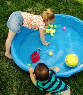 Fun party activities for young kids, such as a kiddie pool full of toys