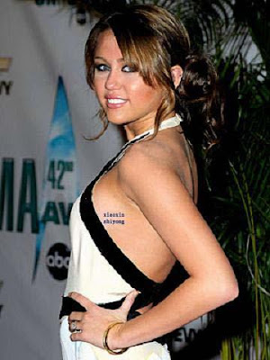 miley cyrus tattoo cross. miley cyrus tattoo finger