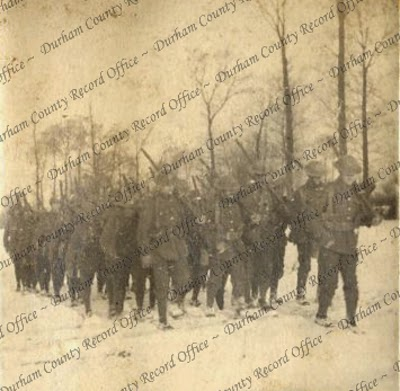 Photograph of soldiers marching across a snow-covered field [possibly in Belgium], n.d. [c.1914 - 1918] (D/DLI 7/951/7(2))