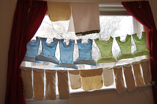 cloth diapers line drying in window