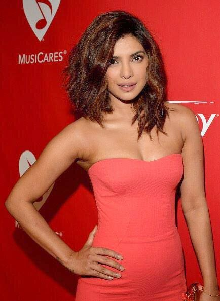Priyanka Chopra in Pinkish Red Dress at MusiCares