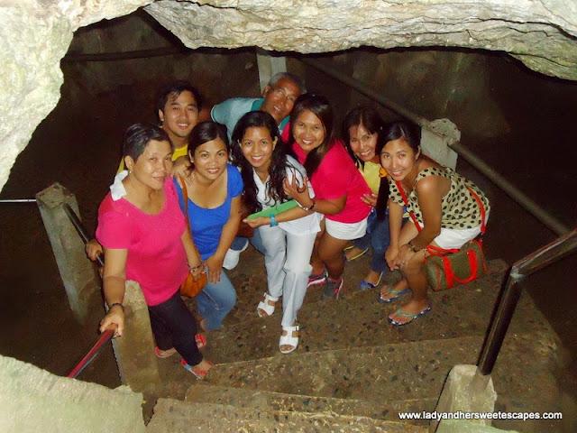 family posing inside Hinagdanan Cave Panglao