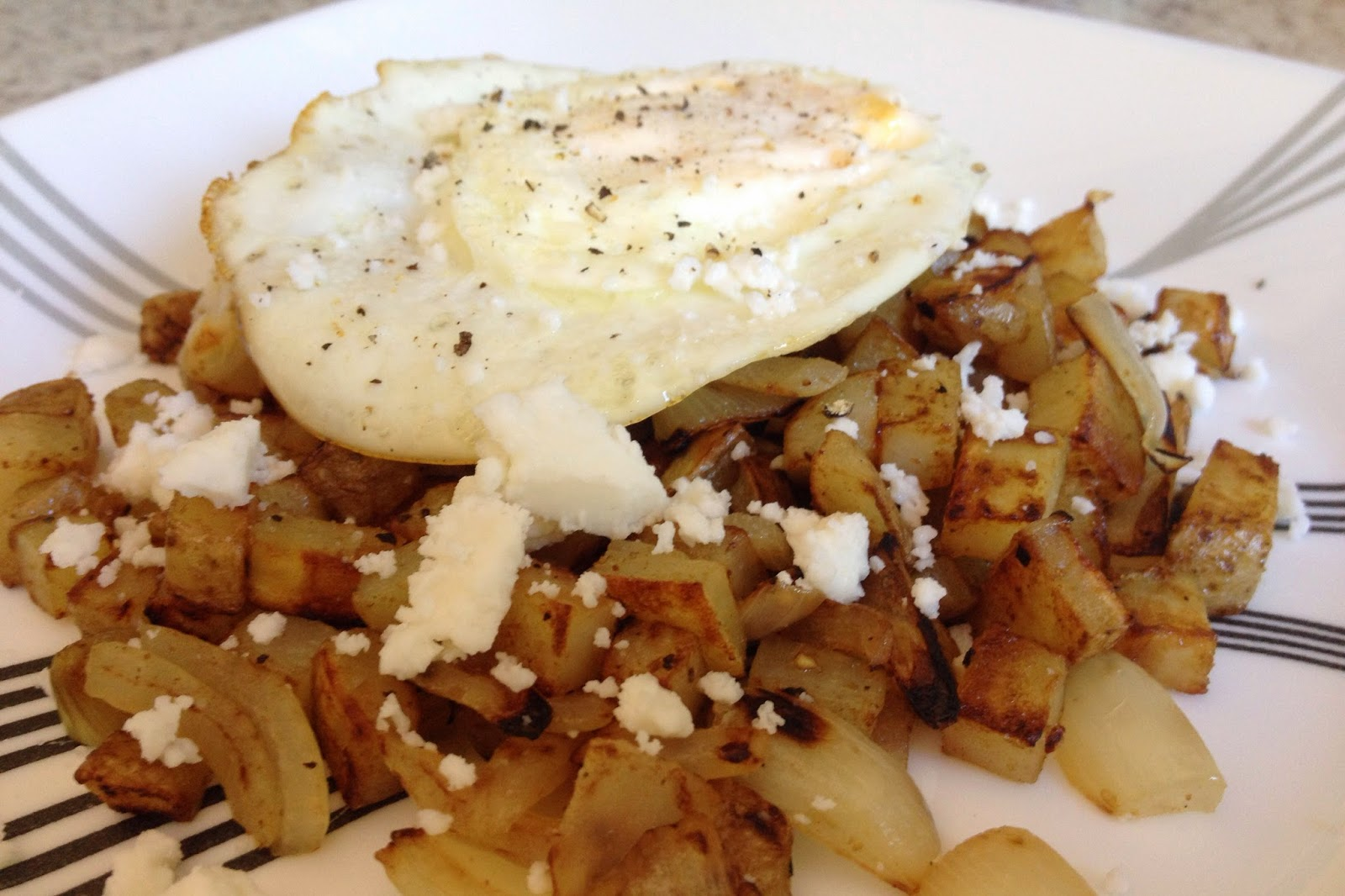 fried egg over potato hash