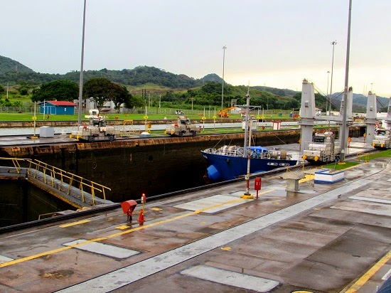 Cargo ship at the lower water level ready to go through the Miraflores locks - Panama Canal