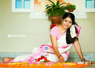Anumol latest hot stills in saree from onam photo shoot