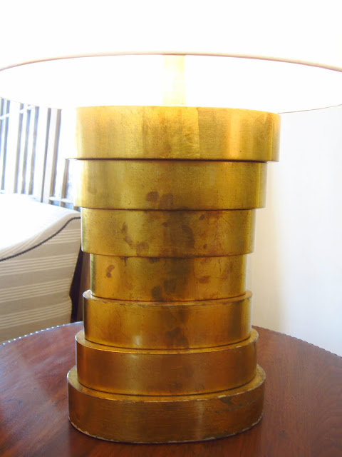 Close up of the stacked, circle base on a brass table lamp