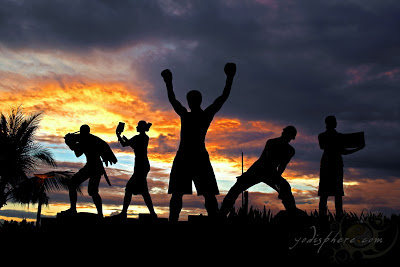 Silhouette of Filipino boxer Manny Pacman Pacquio and other Filipino heroes against the Manila Bay sunset at SM Mall of Asia