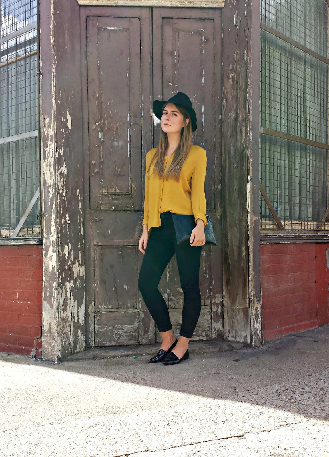 Style Trunk  Outfit Fedora mustard shirt and skinny jeans