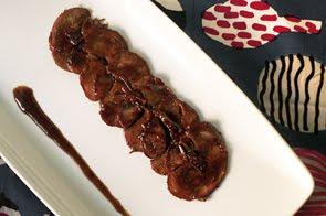 Arrosto di vitello al Pastis in salsa di arancio e cacao
